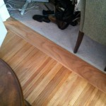 Custom red oak transition between carpet and hardwood.